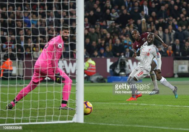 West Ham United's Michail Antonio scores his side's first goal during the Premier League match between West Ham United and Liverpool FC at London...