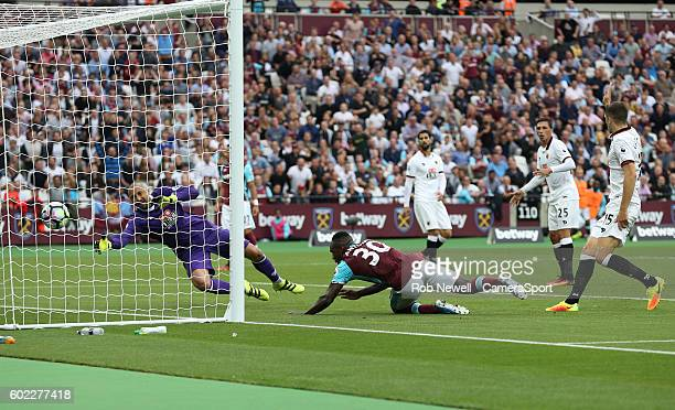 West Ham United's Michail Antonio scores his sides second goal during the Premier League match between West Ham United and Watford at Olympic Stadium...
