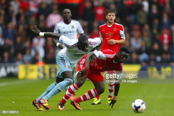 West Ham United's Mohamed Diame and Southampton's Victor Wanyama battle for the ball