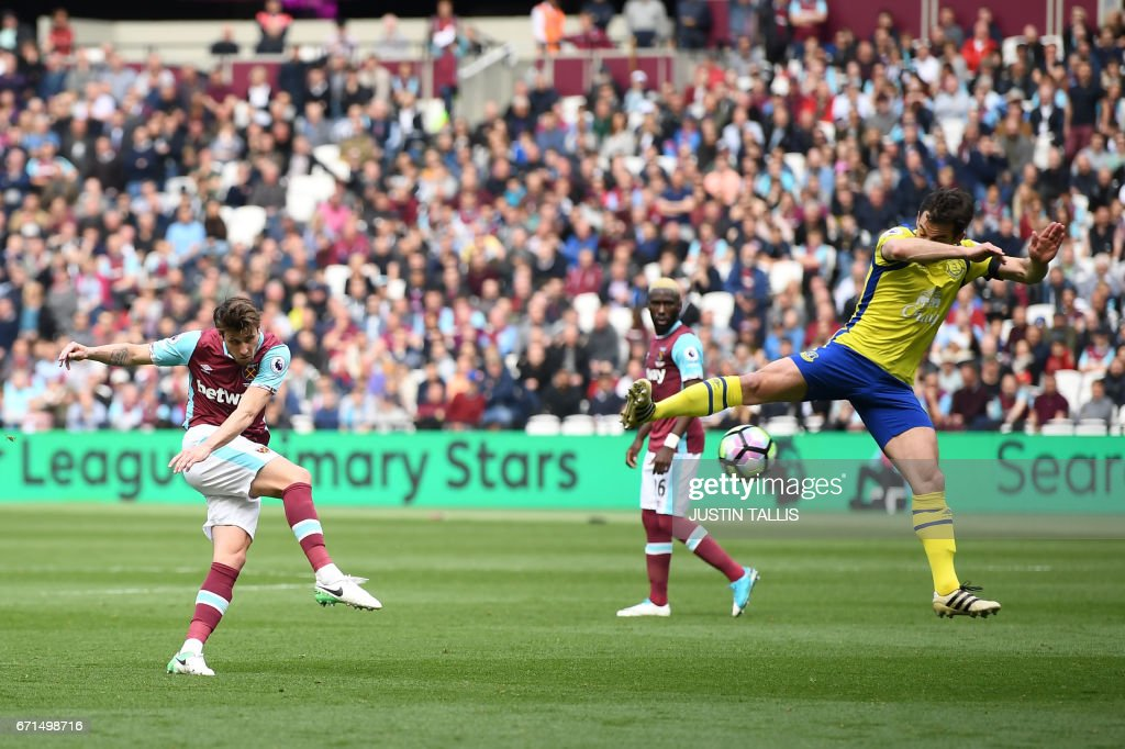 West Ham United's Norwegian midfielder Havard Nordtveit (L) has a shot on goal during the English Premier League football match between West Ham United and Everton at The London Stadium, in east London on April 22, 2017. / AFP PHOTO / Justin TALLIS / RESTRICTED TO EDITORIAL USE. No use with unauthorized audio, video, data, fixture lists, club/league logos or 'live' services. Online in-match use limited to 75 images, no video emulation. No use in betting, games or single club/league/player publications. /