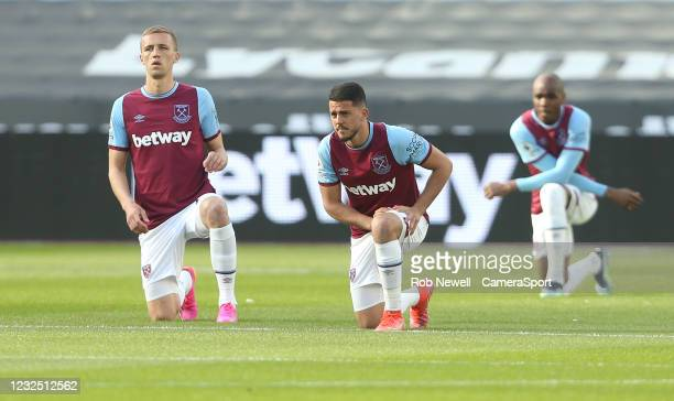 West Ham United's Pablo Fornals, Tomas Soucek and Angelo Ogbonna take the knee prior to kick-off during the Premier League match between West Ham...