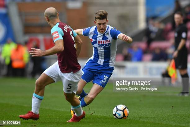 West Ham United's Pablo Zabaleta and Wigan Athletics Callum Elder compete for possession during the Emirates FA Cup fourth round match at the DW...
