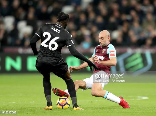 West Ham United's Pablo Zabaleta slides in on Crystal Palace's Bakary Sako during the Premier League match at the London Stadium London
