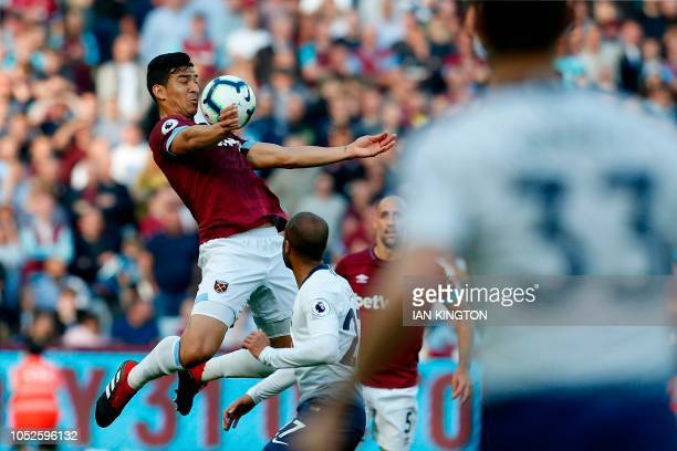 West Ham United's Paraguan defender Fabian Balbuena jumps to control the ball during the English Premier League football match between West Ham...