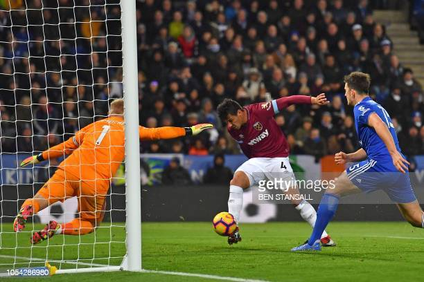West Ham United's Paraguayan defender Fabián Balbuena shoots to score the opening goal after his header comes back off the post during the English...
