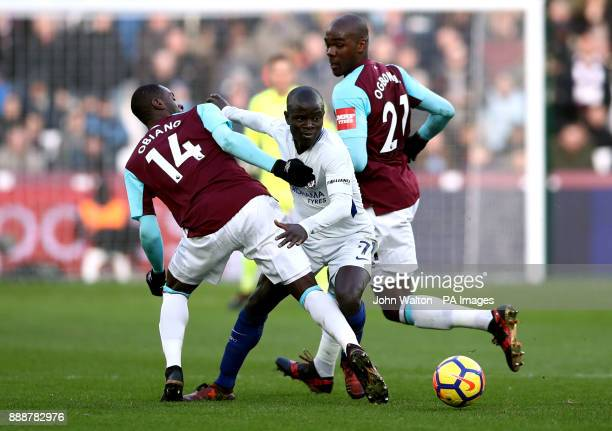 West Ham United's Pedro Obiang and Angelo Ogbonna and Chelsea's Ngolo Kante battle for the ball during the Premier League match at the London Stadium