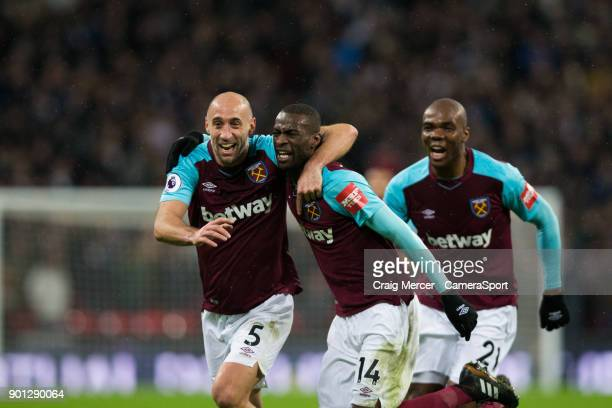 West Ham United's Pedro Obiang celebrates scoring the opening goal with team mate Pablo Zabaleta during the Premier League match between Tottenham...