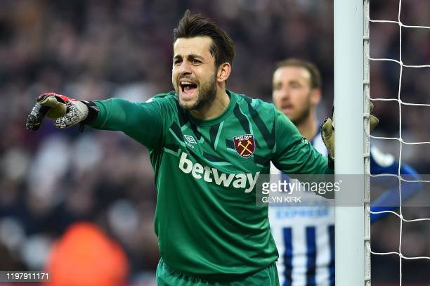 West Ham United's Polish goalkeeper Lukasz Fabianski reacts during the English Premier League football match between West Ham United and Brighton and...