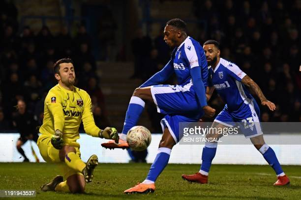 West Ham United's Polish goalkeeper Lukasz Fabianski saves an attempt from Gillingham's English striker Brandon Hanlan during the English FA Cup...