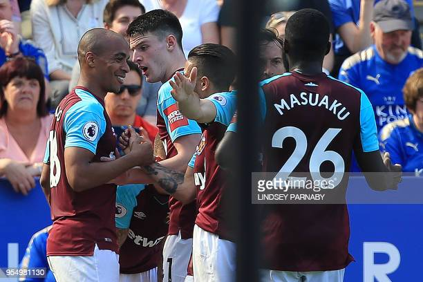 West Ham United's Portuguese midfielder Joao Mario celebrates scoring the opening goal during the English Premier League football match between...