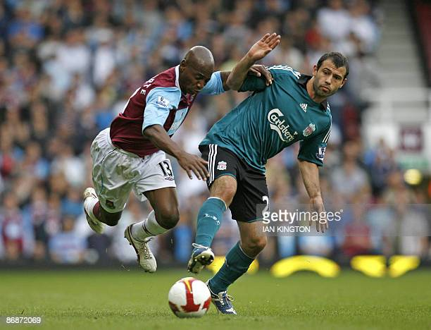 West Ham United's Portuguese player Luis Boa Morte is challenged by Liverpool's Argentinian player Javier Mascherano during the Premier League...