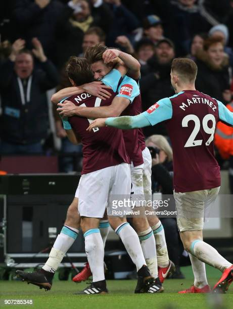 West Ham United's Reece Burke is conratulated by Mark Noble after scoring his side's winning goal during The Emirates FA Cup Third Round Replay match...