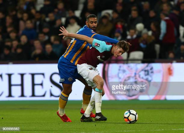 West Ham United's Reece Burke under pressure from Shrewsbury Town's Stefan Payne during FA Cup 3rd Round reply match between West Ham United against...