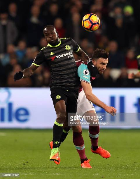 West Ham United's Robert Snodgrass and Chelsea's Victor Moses during the Premier League match at the London Stadium