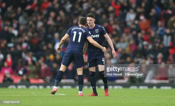 West Ham United's Robert Snodgrass and Declan Rice at the end of the game during the Premier League match between Arsenal FC and West Ham United at...