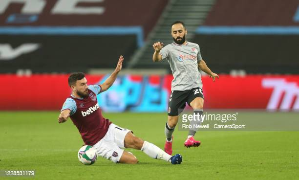 West Ham United's Robert Snodgrass challenges Charlton Athletic's Erhun Oztumer during the Carabao Cup Second Round Northern Section match between...