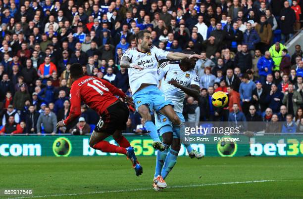 West Ham United's Roger Johnson collides with team mate Guy Demel Demel left the field of play injured during the Barclays Premier League match at...