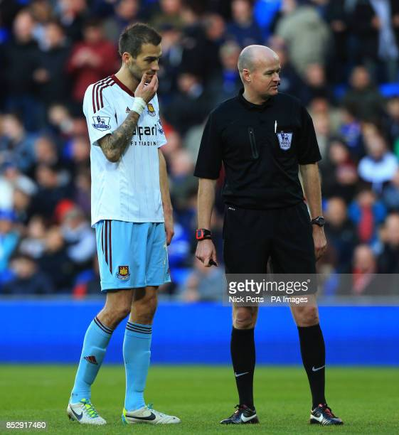 West Ham United's Roger Johnson shows his concern for teammate Guy Demel during game against Cardiff City in the Barclays Premier League match at...