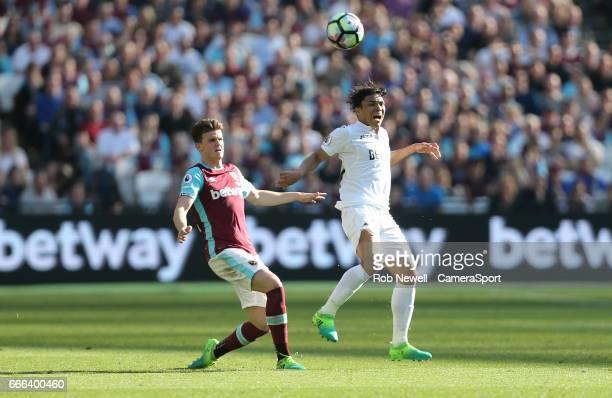 West Ham United's Sam Byram and Swansea City's Jefferson Montero during the Premier League match between West Ham United and Swansea City at London...