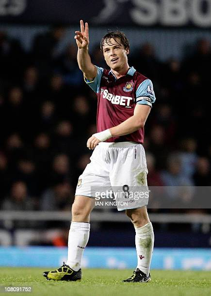 West Ham United's Scott Parker celebrates scoring his goal against Stoke City during the league cup fourth round football match at Upton Park in...