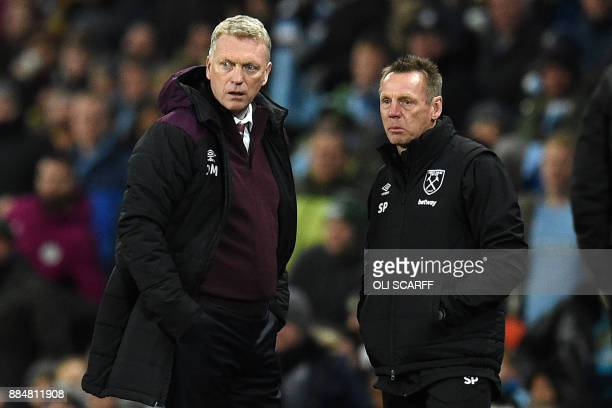 West Ham United's Scottish manager David Moyes and coaching assitant Stuart Pearce watch from the touchline during the English Premier League...