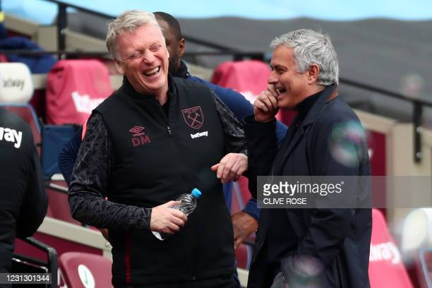 West Ham United's Scottish manager David Moyes and Tottenham Hotspur's Portuguese head coach Jose Mourinho share a joke ahead of kick off in the...