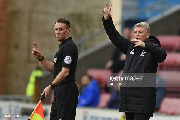 West Ham United's Scottish manager David Moyes gestures on the touchline beside the assistant referee during the English FA Cup fourth round football...