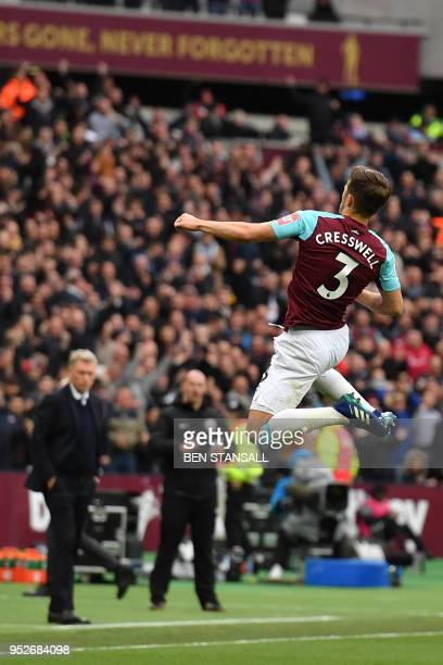 West Ham United's Scottish manager David Moyes looks on as West Ham United's English defender Aaron Cresswell celebrates after scoring their first...