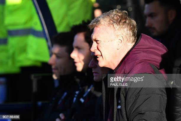 West Ham United's Scottish manager David Moyes looks on before the English FA Cup third round football match between Shrewsbury Town and West Ham...
