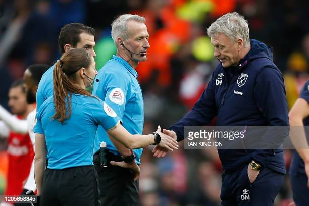 West Ham United's Scottish manager David Moyes shakes hands with Assistant referee Sian MasseyEllis after the English Premier League football match...