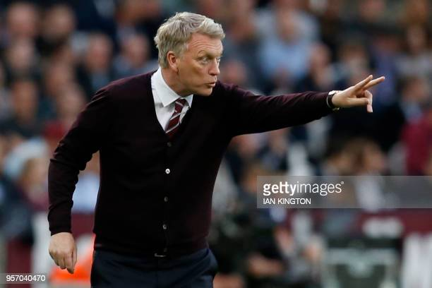 West Ham United's Scottish manager David Moyes shouts instructions to his players from the touchline during the English Premier League football match...