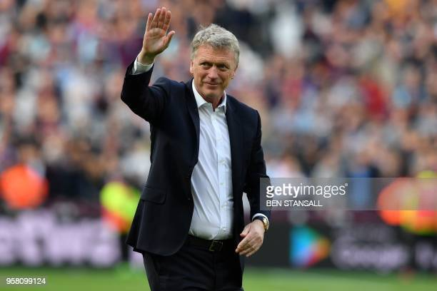 West Ham United's Scottish manager David Moyes waves to supporters on the pitch after the English Premier League football match between West Ham...