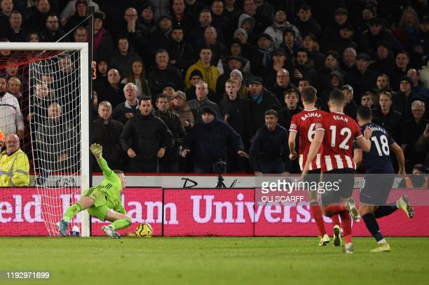 West Ham United's Scottish midfielder Robert Snodgrass beats Sheffield United's English goalkeeper Dean Henderson before the goal is ruled out by VAR...
