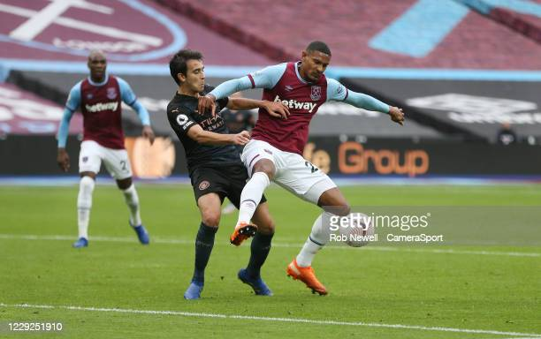 West Ham United's Sebastien Haller and Manchester City's Eric Garcia during the Premier League match between West Ham United and Manchester City at...