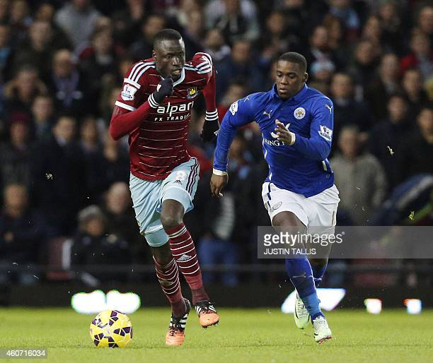 West Ham United's Senegalese midfielder Cheikhou Kouyate vies with Leicester City's Ghanaian striker Jeff Schlupp during the English Premier League...