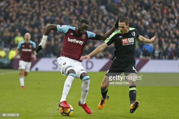 West Ham United's Senegalese midfielder Cheikhou Kouyate vies with Bournemouth's English midfielder Dan Gosling during the English Premier League...