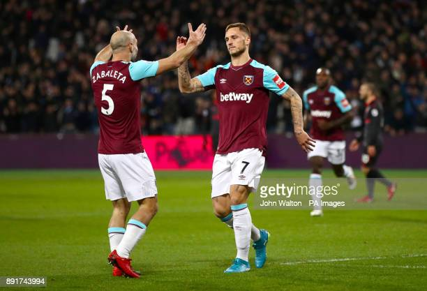 West Ham United's Sofiane Feghouli celebrates scoring his side's first goal of the game with team mate West Ham United's Pablo Zabaleta the goal is...