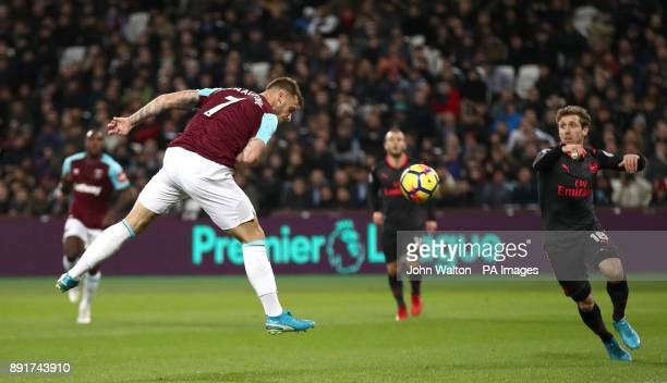 West Ham United's Sofiane Feghouli scores his side's first goal of the game which is later disallowed during the Premier League match at London...
