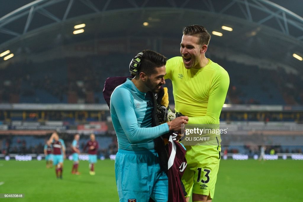 West Ham United's Spanish goalkeeper Adrian (R) and West Ham United's Argentinian midfielder Manuel Lanzini (L) celebrate at the end of the English Premier League football match between Huddersfield Town and West Ham United at the John Smith's stadium in Huddersfield, northern England on January 13, 2018. / AFP PHOTO / Oli SCARFF / RESTRICTED TO EDITORIAL USE. No use with unauthorized audio, video, data, fixture lists, club/league logos or 'live' services. Online in-match use limited to 75 images, no video emulation. No use in betting, games or single club/league/player publications. /