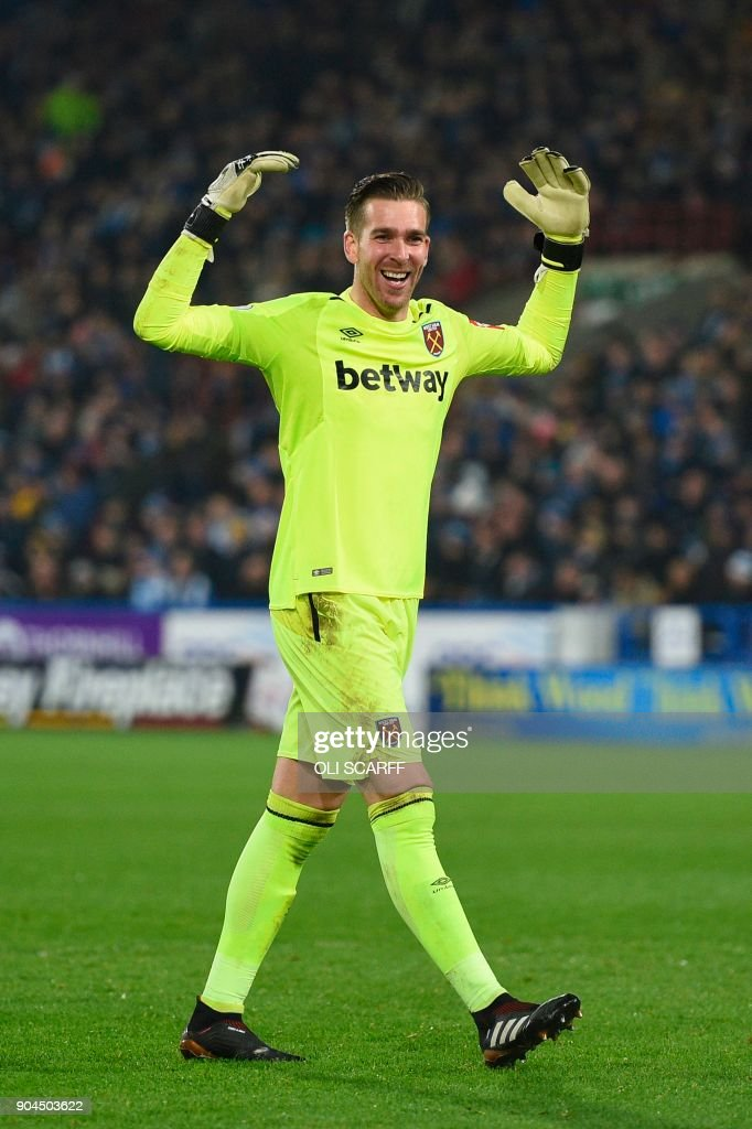 West Ham United's Spanish goalkeeper Adrian celebrates after West Ham United's Argentinian midfielder Manuel Lanzini scored their fourth goal during the English Premier League football match between Huddersfield Town and West Ham United at the John Smith's stadium in Huddersfield, northern England on January 13, 2018. / AFP PHOTO / Oli SCARFF / RESTRICTED TO EDITORIAL USE. No use with unauthorized audio, video, data, fixture lists, club/league logos or 'live' services. Online in-match use limited to 75 images, no video emulation. No use in betting, games or single club/league/player publications. /