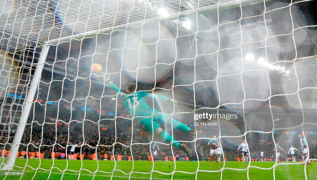 West Ham United's Spanish goalkeeper Adrian (C) dives but fails to stop the shot from Tottenham Hotspur's South Korean striker Son Heung-Min for Tottenham's equalising goal during the English Premier League football match between Tottenham Hotspur and West Ham United at Wembley Stadium in London, on January 4, 2018. / AFP PHOTO / Glyn KIRK / RESTRICTED TO EDITORIAL USE. No use with unauthorized audio, video, data, fixture lists, club/league logos or 'live' services. Online in-match use limited to 75 images, no video emulation. No use in betting, games or single club/league/player publications. /