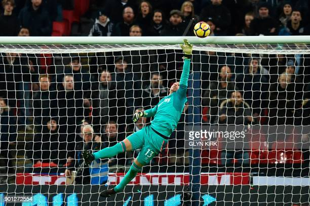TOPSHOT West Ham United's Spanish goalkeeper Adrian makes a save during the English Premier League football match between Tottenham Hotspur and West...