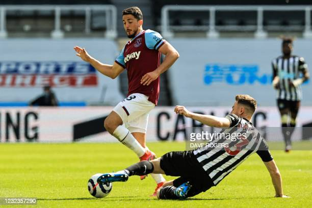 West Ham United's Spanish midfielder Pablo Fornals fights for the ball with Newcastle United's Welsh defender Paul Dummett during the English Premier...