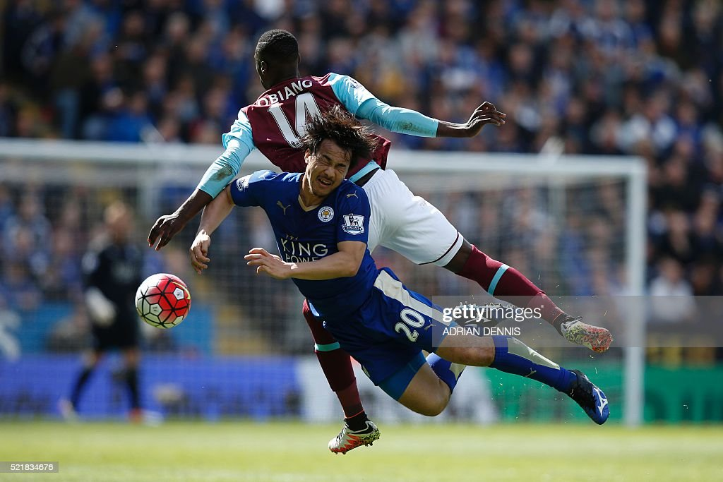 West Ham United's Spanish midfielder Pedro Obiang (back) and Leicester City's Japanese striker Shinji Okazaki (front) battle for the ball during the English Premier League football match between Leicester City and West Ham United at King Power Stadium in Leicester, central England on April 17, 2016. / AFP / ADRIAN DENNIS / RESTRICTED TO EDITORIAL USE. No use with unauthorized audio, video, data, fixture lists, club/league logos or 'live' services. Online in-match use limited to 75 images, no video emulation. No use in betting, games or single club/league/player publications. /
