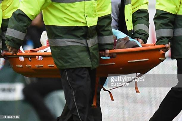 TOPSHOT West Ham United's Spanish midfielder Pedro Obiang is taken from the field on a stretcher after picking up an injury during the English FA Cup...