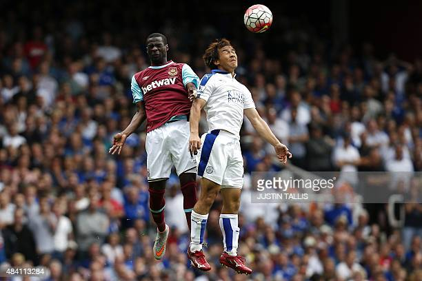 West Ham United's Spanish midfielder Pedro Obiang jumps for a header with Leicester City's Japanese striker Shinji Okazaki during the English Premier...