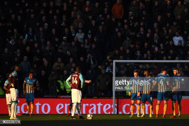 West Ham United's Spanish midfielder Pedro Obiang prepare for a free kick during the English FA Cup third round football match between Shrewsbury...