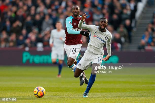 West Ham United's Spanish midfielder Pedro Obiang vies with Chelsea's French midfielder Tiemoue Bakayoko during the English Premier League football...