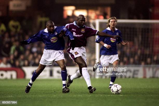 West Ham United's Titi Camara tries to shove Leicester City's Andy Impey off the ball