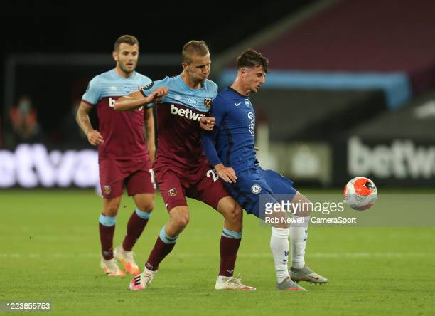 West Ham United's Tomas Soucek and Chelsea's Mason Mount during the Premier League match between West Ham United and Chelsea FC at London Stadium on...
